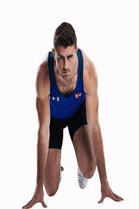 Sportsman in sprint starting position