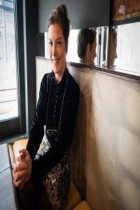 Author Caoilinn Hughes sat on sofa