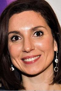 Dr Lisa Messina smiling at camera