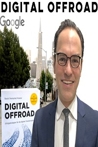 Head shot of Dr Ulf Bosch in front of Digital Offroad sign