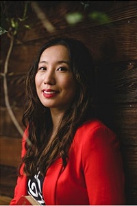 Profile picture of Dr Xine Yao. Wearing red jacket