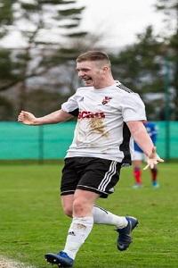 Footballer celebrating on the pitch