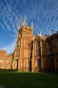Lanyon Building, Queen's University Belfast in sunlight and shade. Blue sky with wispy clouds