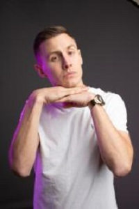 Profile picture of Shane Todd wearing white tshirt and resting chin on hands