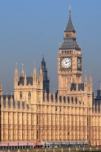 Palace of Westminster in sunlight with blue sky