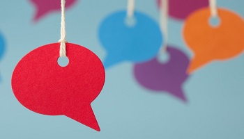 Speech bubbles in red, blue, orange and purple hanging by string