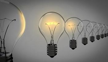 Row of opaque and lit lightbulbs