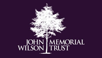 John Wilson Memorial Trust logo featuring silhouetted tree in centre of wording
