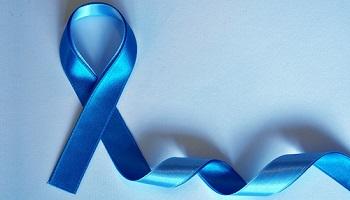 Blue ribbon against light blue background