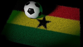 Football on astro turf in colours of flag of Ghana