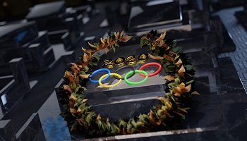 Olympic rings surrounded by winner's garland