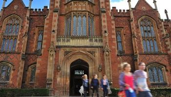 Front door of Queen's Lanyon Building, showing students emerging