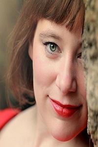 Elizabeth Hillard, smiling slightly her left eye obscured